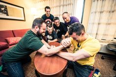 Groomsmen arm wrestle in superhero t-shirts  #Michiganwedding #Chicagowedding #MikeStaffProductions #wedding #reception #weddingphotography #weddingdj #weddingvideography #wedding #photos #wedding #pictures #ideas #planning #DJ #photography #pre-ceremony #groom
