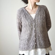 Ivy Line by Yoko Johnston, an A-line swing cardigan with vine lace on the front, pattern available on Ravelry.