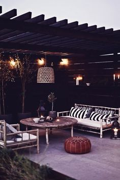 I actually like the black wood walls, could add warmth to the backyard