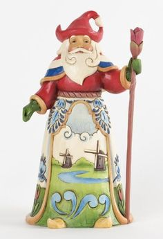 Dutch Santa - Dutch Traditions--The Santas Around the World collection showcases Christmas traditions from all over the globe. This delightful Dutch Santa features windmills; tulips and iconic rosemaling rendered in traditional Delft blue and white.