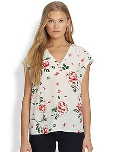 Joie Suela Printed Silk Top Feminine floral print on luxe silk with an alluring v-neck and sweet cap sleeves.porcelian