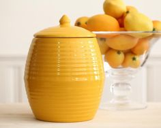 """- Overview - Details/Shipping - Artisan Spotlight Exemplifying the classic California """"ringware"""" style introduced by Bauer back in 1933, add a splash of streamlined architectural design to your kitche Bauer Pottery, Orange Cookies, Cookie Crumbs, Vintage Cookies, Mellow Yellow, Color Yellow, Vintage Pottery, Cookie Jars, Safe Food"""