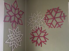 DIY Popsicle Sticks Wall Art    There is an interesting way to keep your winter holidays on, use the Popsicle sticks to make marvelous snowflakes and pin them up on the walls to lend a different look to it. You can paint the sticks with various colors to make it more prominent.