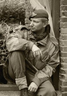 WWII British Soldier Immagine he's sitting at the top of a building... hawkeye's dad