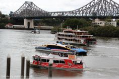 Boats passing by... on Brisbane River, Brisbane near the Storey Bridge photo by jadoretotravel