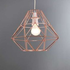 Featuring a contemporary geometric frame this ceiling pendant has one light bulb fitting and is complete with a copper effect finish. Please note: Bulbs are not included. Copper Lamps, Copper Lighting, Flush Lighting, Pendant Lighting, Ceiling Pendant, Pendant Lamp, Copper Ceiling, Lampe Rose, Copper Living Room