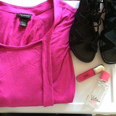 Pink blouse Pretty blouse! It's a bright pink color. Rounded neckline. The sleeves are just past elbow length. It's a very stretchy fabric. 96% rayon and 4% spandex. It's marked as 26/28. It can also fit 22/24 if you want a more flowy look. Lane Bryant Tops Blouses
