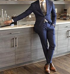 Great suit in a sleek kitchen for a shot that captures style in the kitchen. #styleonthestove