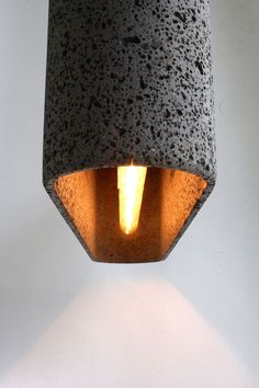 """Basalt Lava Pendant Lamp (via freshome) Check out the """"making of"""" video. Very cool & labor intensive!"""