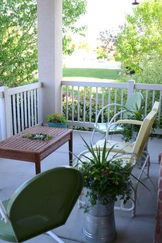 Cleaning up your front porch...love the plants in the galvanized buckets on top of turned over buckets.