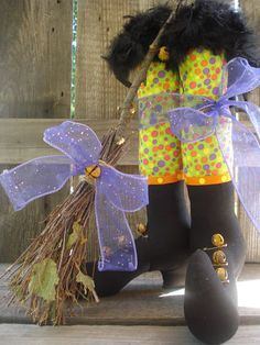 Primitive Witch Boots cotton fabric, rusty bells feather boa, ribbon holds item together all hand made.