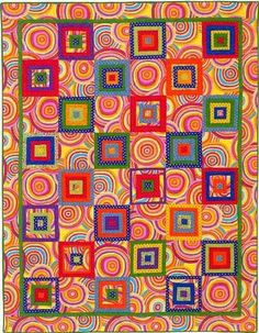 """Kaffe Fassett fabrics -- my favorite- I have a swirl-circle design that I could use for the """"plain"""" blocks."""