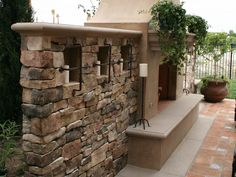 Conversation Piece    This Mediterranean yard boasts an oversized custom fireplace with 12-feet-high candle walls, custom-built wrought iron spark arrestor and candle cages. Designed by Mitch Kalamian.