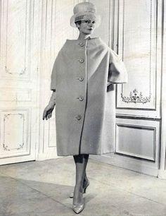 Model wearing a coat by Pierre Cardin, 1959.