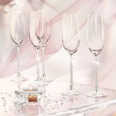 Champagne flutes with crystal-filled stems, I'd love to use these to toast at my wedding! But, a little on the pricey side.... $390 for a set of two.