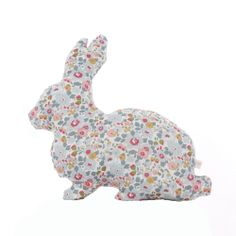 This whimsical handmade Liberty rabbit cushion would look perfect on a bed or a favourite chair.DETAILS:Handmade from the softest cotton, this sweet Liberty rabbit cushion comes in Liberty Betsy print on both sides. The Betsy print is a lovely mix of pinks, greys and blues.This makes a sweet and unique gift for any little girl. Why not treat your little one to a matching name garland or mobile