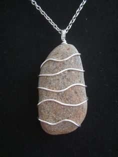 Wire wrapped stone pendant.