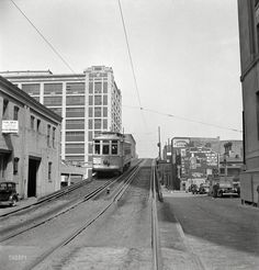 April 1943. Baltimore, Maryland. Elevated trolley. A restaurant, gas station, public transportation and booze all in one handy view. Photo by Marjory Collins for the Office of War Information.