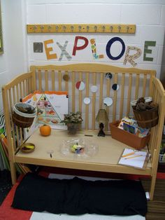 Baby crib converted into a science center. Great for early childhood exploration.