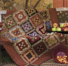 Churn Dash pattern with a NinePatch in the middle- love those fall colors! Must add this one to my Quilts to-do list