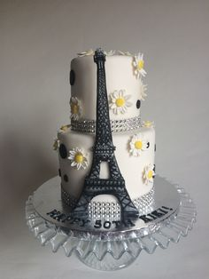 Spring in Paris themed birthday cake with Eiffel Tower and polka dots.