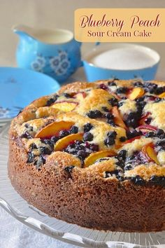 Blueberry Peach Sour Cream Cake - a marriage of great seasonal flavors! A summer into fall recipe taking advantage of seasonal fruits when they are both available. Perfect for a late summer brunch or as a great close to a BBQ dinner.