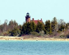 "Squaw Island MI Source of Image:	Charles Bash (USA) Date of Image:	Unknown     International Designation Number:  Unknown    Navigation: Latitude	44° 50"" 21' N Longitude	85° 35"" 16' W Body of water	Lake Michigan.  Located on a remote island 6 miles (10 km) northwest of St. James (Beaver Island).    Construction: Date of Establishment:	1892 Date Light First Lit:	1892 Designer	 Is structure still operating?	No. Inactive since 1928."