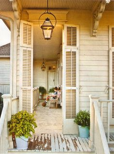 Love this shuttered porch entrance. Would love to do that to all the windows under our porches! Outdoor Rooms, Outdoor Living, Outdoor Decor, Outdoor Kitchens, Fachada Colonial, Copper Lighting, Porch Lighting, Cool Ideas, Beach Cottages