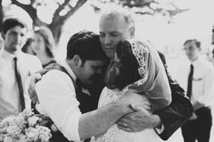 Father of the bride embrace.