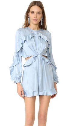 This lustrous, fluid Zimmermann romper pairs flirty style with retro charm. Dramatic cutouts detail the waist, and draped ruffles add fluttering volume. Long blouson sleeves. Button and tie closures in back. Hidden side zip. Unlined.