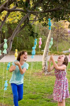 DIY Egg Popper Tree turn plastic eggs into candy filled poppers, wrapped up like little egg-shaped candies themselves!