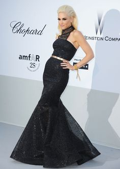 Gwen Stefani - shimmery black frock with a lace halter neck and gold belt.  (Brand: L.A.M.B)