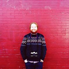 a redhead + a red wall = awesomeness. & yes, my friend andy is as awesome as he looks.
