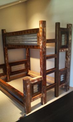 Twin/Queen Rustic Trim with Tin Bunk Bed. Posts are old barn beams with some white paint sanded down .