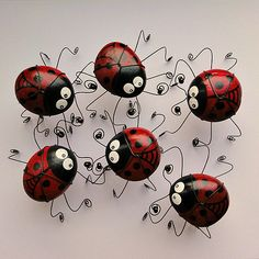 Ladybug painted rocks with wire legs