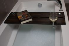 Our handmade quality wood bath caddy / board  Our Caddy's / board's have a slot perfect for your electronic device such as iPad/phone/tablet, flat bottomed hole for tea light candles & a slot for your wine glass to rest securely   We've designed our board wider than most making it safer when using iPads or Tablets.  Plus you can fit a lot more on with out feeling cramped for space.  All our boards are made from wood so they will have knots, grooves and grains in them. Wood Bath, Bath Tub, Tea Light Candles, Tea Lights, Bath Board, Electronic Devices, Ipads, Bath Caddy, Primary Colors