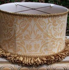 Old World Fortuny Lampshade ~ Medium Oval Drum Antique Gold with Custom Trim —Available at studioveneto.com