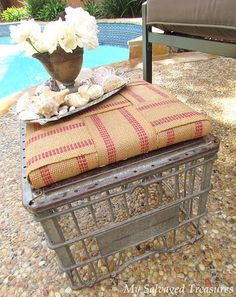 Turn a rusty old milk crate into a footstool with the help of some jute webbing, batting, and an old board. From MySalvagedTreasures.com