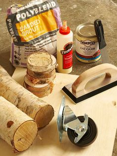 You'll need plywood, birch logs, wood glue, and sanded grout.