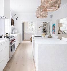 white natural modern kitchen pale wood floors.