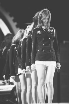 SNSD; Girls' Generation if Im guessing they are about to do GENIE.