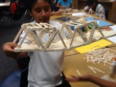 Integrate S.T.E.M Project-Based Learning Building Bridges with Popsicle Sticks.  Attach weights and measure quantitative data while analyzing which designs are the strongest!