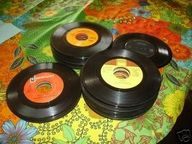 45's!!!!!!!!!!!!!!!!!!!!!!!!!!I remeber when they cost a dollar and you had to order them threw our confectionary. couldn't wait for the weekends to ge pick them up and wear everyones ears off by listening to them ALL the time over and over again. lol