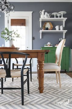Say goodbye to a matching dining room set. I love mixing styles to create a collected look. Here, these traditional upholstered chairs from HomeGoods (sponsored) work beautiful as head chairs at my dining room table.