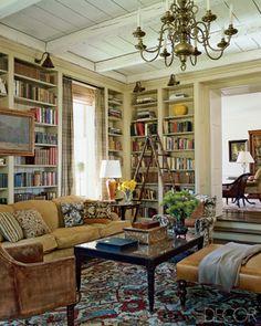 Built-in bookshelves and plank ceiling.
