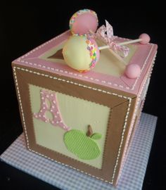... clever... Girl Baby Block Cake with Cake Pop Rattles.