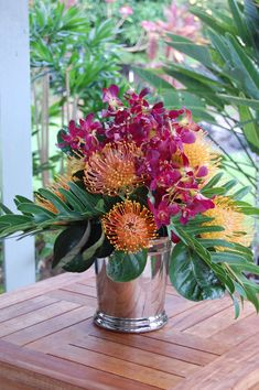 Should always have fresh tropical flower arrangement in my home....