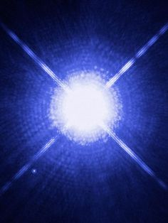 Sirius and Sirius B The brightest star in the nighttime sky, Sirius, or the Dog Star, greatly outshines its white dwarf companion, Sirius B. At 8.6 light-years away, Sirius B is the nearest known white dwarf star to Earth.