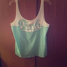 VS PINK UNIQUE TANK •Extremely unique tank by VS PINK •Mint and white, scoop neck in back• Truly one of a kind•BNWT-Never WORN•ANY 2 VS PINK TANKS OR TEES FOR $28 ❌NO OFFERS❌ NO TRADES❌ •IF INTERESTED IN 2 for $28 COMMENT AND I WILL MAKE YOU A SEPARATE LISTING! PINK Victoria's Secret Tops Tank Tops