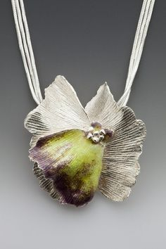 Necklace   Lynn Cobb.  Sterling silver with plum and yellow enamel on one petal.